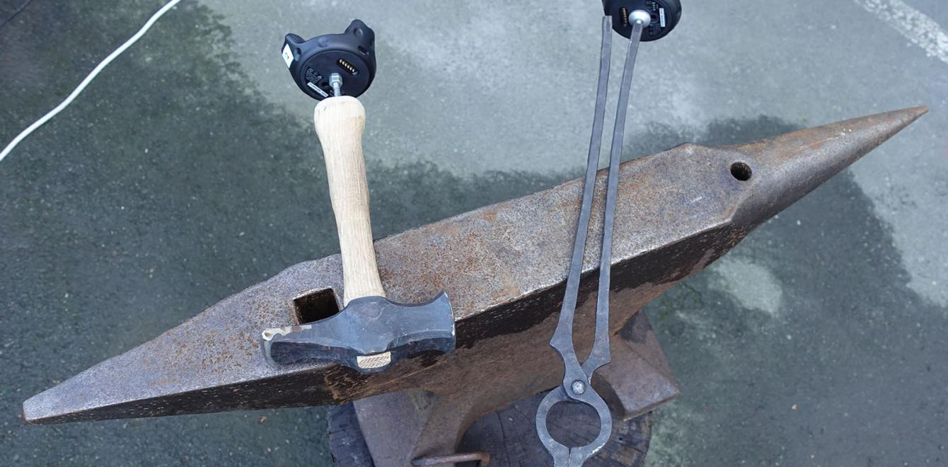 An anvil with a motion tracked hammer and pliers